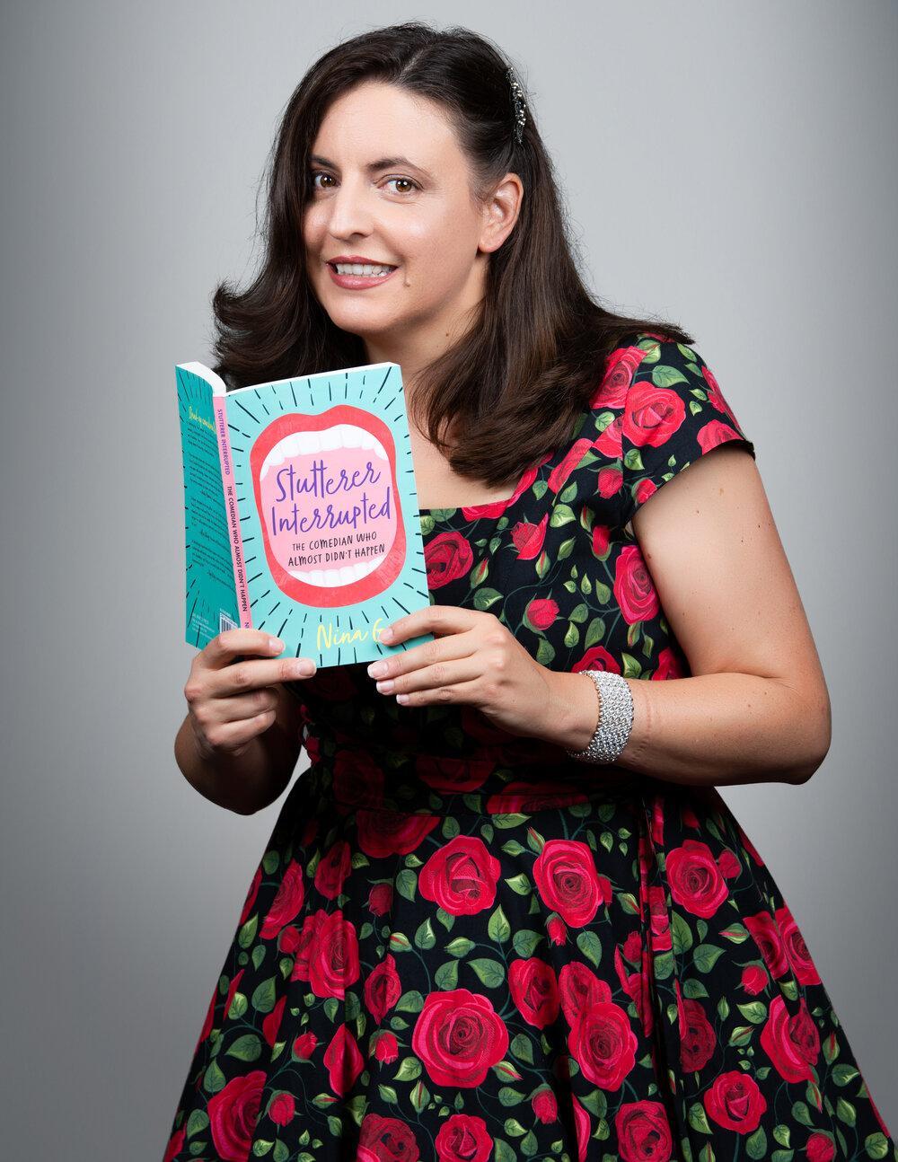 """Image of Nina G holding her book """"Stutterer Interrupted"""""""